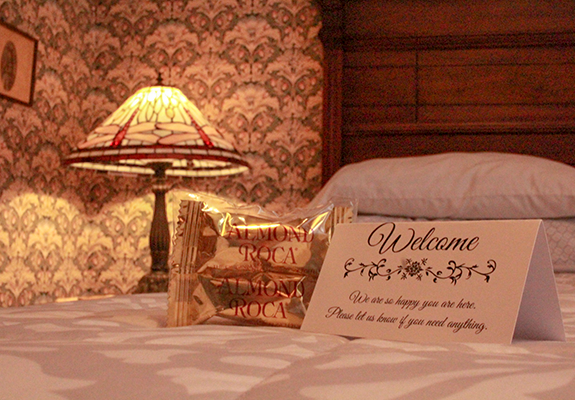welcome card on bed